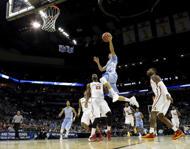 North Carolina's Marcus Paige (5) goes up for a shot as Iowa State's Dustin Hogue (22) defends during the first half of a third-round game in the NCAA college basketball tournament Sunday, March 23, 2014, in San Antonio. (AP Photo/David J. Phillip)