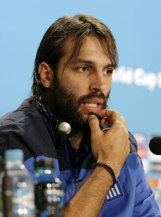 Greece's Giorgos Samaras talks to the media at a press conference on the day before the group C World Cup soccer match between Colombia and Greece at the Mineirao Stadium in Belo Horizonte, Brazil, Friday, June 13, 2014. (AP Photo/Fernando Vergara)