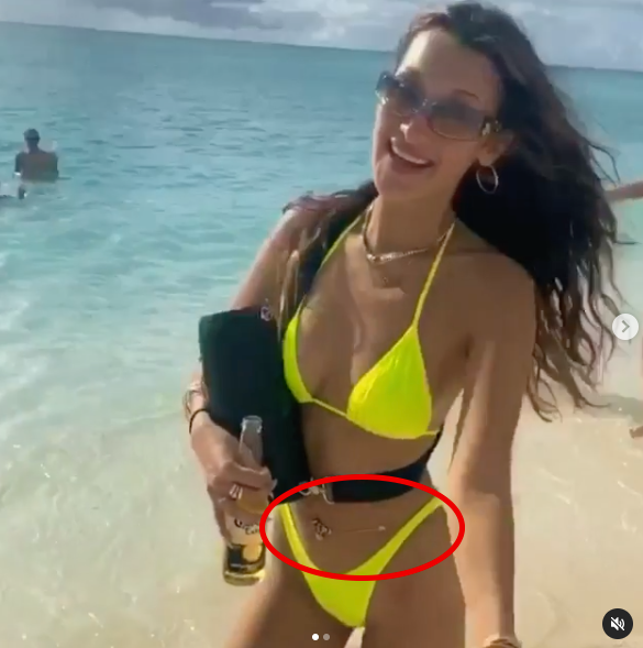 Bella Hadid wears body chain in beach photo