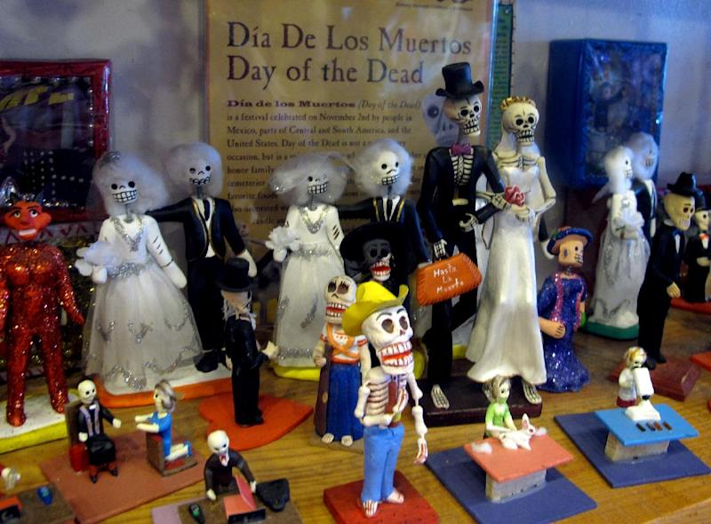 "In this May 8, 2013 photo, artwork is shown at Masks y Mas, an Albuquerque shop that sells 'Day of the Dead' art year round. Disney announced Tuesday that it was a withdrawing a ""Dia de los Muertos"" trademark request it made to the U.S. Patent and Trademark Office amid uproar on social media from Latino activists, writer and artists. Disney had sought to secure naming right for an upcoming animated movie inspired by the holiday. Critics said the move to trademark a cultural holiday was insensitive. (AP Photo/Russell Contreras)"