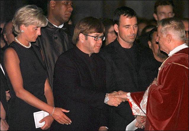 Princess Diana with Elton John at the requiem mass for Gianni Versace in Milan, 1997. (Photo: Gerard Julien/AFP/Getty Images)