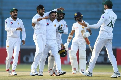 Pakistan players celebrate a wicket on their way to victory over Sri Lanka in Karachi