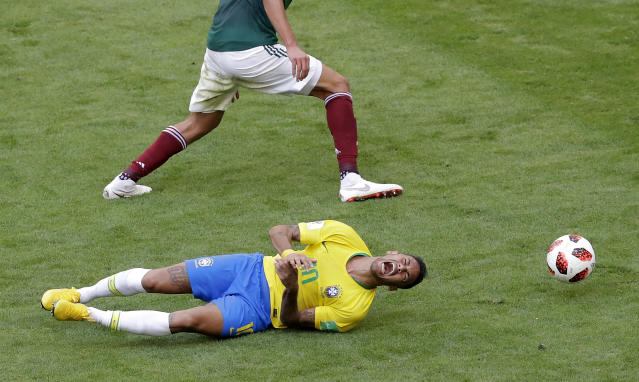 <p>Brazil's Neymar, bottom, challenges for the ball with Mexico's Edson Alvarez during the round of 16 match between Brazil and Mexico at the 2018 soccer World Cup in the Samara Arena, in Samara, Russia, Monday, July 2, 2018. (AP Photo/Sergei Grits) </p>