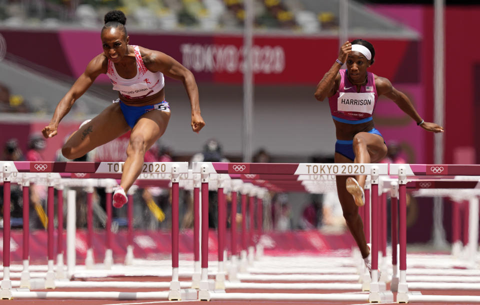 Jasmine Camacho-Quinn, of Puerto Rico, clears the final hurdle to win gold ahead of Kendra Harrison, of United States, silver, in the women's 100-meters hurdles final at the 2020 Summer Olympics, Monday, Aug. 2, 2021, in Tokyo, Japan. (AP Photo/Martin Meissner)