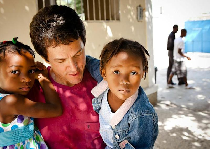 Albom with two children at the orphanage | Courtesy Mitch Albom