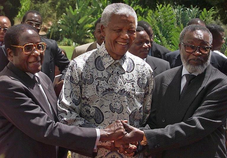 The three presidents of South Africa, Nelson Mandela, Zimbabwe's Robert Mugabe and Namibia's Sam Nujoma on 05 March 1999
