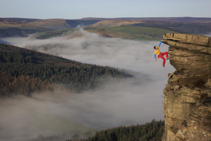 Mike Hutton hangs from Gargoyle Flake in the Peak District in England. (Photo: Mike Hutton/Caters News)