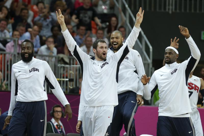 USA's Kevin Love raises his arms as he celebrates after a 3-pointer by teammate Carmelo Anthony during a men's basketball game against Nigeria at the 2012 Summer Olympics, Thursday, Aug. 2, 2012, in London. (AP Photo/Charles Krupa)