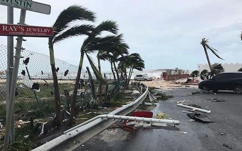 This Sept. 6, 2017 photo shows storm damage in the aftermath of Hurricane Irma, in St. Martin. Irma cut a path of devastation across the northern Caribbean, leaving thousands homeless after destroying buildings and uprooting trees - Credit: Jonathan Falwell via AP
