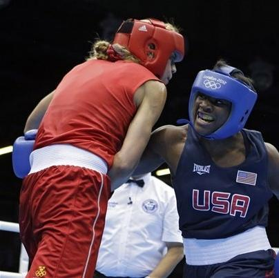 United States' Claressa Shields, right, fights Sweden's Anna Laurell in a women's middleweight 75-kg quarterfinal boxing match at the 2012 Summer Olympics, Monday, Aug. 6, 2012, in London. (AP Photo/Patrick Semansky)