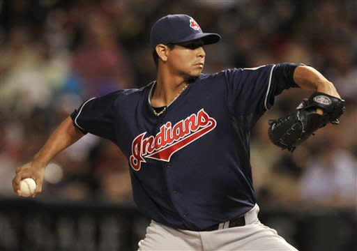 Cleveland Indians starter Carlos Carrasco delivers a pitch during the first inning of the second game of a doubleheader baseball game against the Chicago White Sox in Chicago, Friday, June 28, 2013. (AP Photo/Paul Beaty)