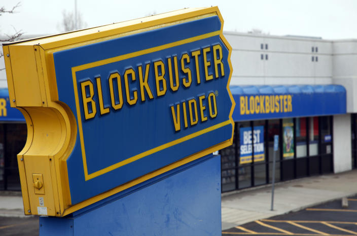The Blockbuster movie rental store is open for business in the Denver suburb of Broomfield, Colorado April 6, 2011. Dish Network Corp won Blockbuster Inc in a bankruptcy auction for about $320 million, boosting the satellite TV provider's online features and marketing reach. Dish, the second-largest U.S. satellite TV company after DirecTV, trumped at least three other bidders, including activist investor Carl Icahn, for the one-time leader in video rentals. REUTERS/Rick Wilking (UNITED STATES - Tags: BUSINESS)