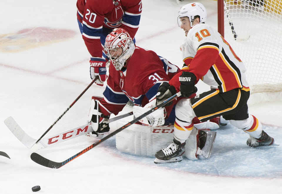 Calgary Flames' Derek Ryan moves in on Montreal Canadiens goaltender Carey Price during third period NHL hockey action in Montreal, Monday, Jan. 13, 2020. (Graham Hughes/The Canadian Press via AP)
