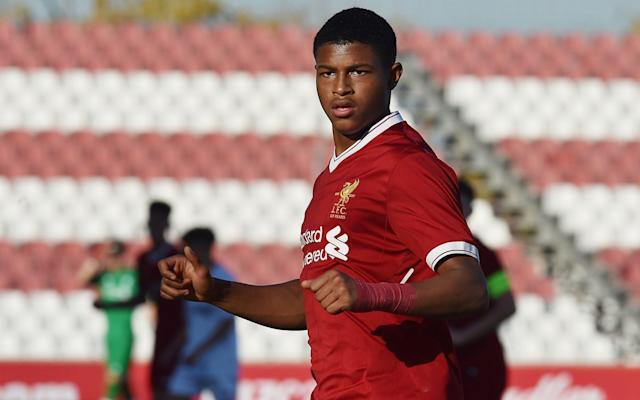 "Liverpool have agreed a ­professional contract with their teenage sensation Rhian Brewster, ending fears the England youth ­international could quit Anfield. Manager Jurgen Klopp and sporting director Michael Edwards have been in constant negotiations with Brewster and his representative to secure the 18-year-old on what is understood to be a five-year contract, retaining him until 2023. The striker's burning ambition had opened up the possibility of him moving elsewhere where he may have been guaranteed a more rapid promotion to first-team football. But Klopp and Edwards sought to reassure him the pathway to the Liverpool starting line-up was there should potential be fulfilled. Brewster will be part of the ­senior squad when they return to pre-season training and, after a breakthrough in talks, he will put pen to paper on the long-term ­contract in the coming days. For all the business Liverpool have done and may yet do this ­summer, tying down Brewster may prove one of the most significant should he take his exceptional form at youth level onto the senior stage. Liverpool feared losing Rhian Brewster (left) to Germany Credit: getty images He was the star of last season's Under-17 World Cup, winning the Golden Boot, as England were crowned champions. He is ­regarded as one of the most exciting players of his age in world football. Liverpool were genuinely concerned about losing Brewster at one point at the end of last season – he has been on a scholarship deal, despite being eligible for a ­professional contract since turning18 in April. Clubs in Germany ­circled offering a direct route to top-level football in the Bundesliga. The club went so far as to threaten Borussia Monchengladbach with a report to Fifa for an ­illegal approach, and relations were soured to the extent of a pre-season friendly between the clubs being cancelled. Now Brewster can expect to make his senior debut in a ­Liverpool jersey in the very near future. Brewster may have featured in the Premier League already, but for an ankle injury towards the end of last season. That may curtail how soon he can start pre-season with the rest of the squad, but he is ­expected to be fit to tour the United States next month. The determination and influence of Klopp and Edwards in convincing Brewster to remain cannot be underestimated, especially as there has been a growing trend of ­exciting England youth players moving to Germany. Rhian Brewster won the U17 World Cup with England Credit: reuters Liverpool were in a strong position to argue there is no elite manager in the Premier League more determined to give his academy players a chance. Klopp has demonstrated throughout his career his preference is to coach and develop those players he values at his club, before looking elsewhere. The opportunity will be there for Brewster to prove he can challenge the lauded Liverpool front three prior to establishing a starting place as his career develops. At the end of last season, Klopp asked Brewster to attend the Football Writers' Association player of the year dinner alongside Mohamed Salah, so a tribute could be paid to the youngster for publicly expressing his despair with Uefa and Fifa's lame efforts to combat on-field racist abuse. Brewster said he was targeted for both club and country, but insufficient evidence meant no action was taken against those he accused. ""Rhain spoke about racism in modern football with the same power, command and composure that he shows when playing,"" said Klopp. This was another sign of how much the Liverpool manager valued the character of the starlet as much as the talent and will surely have helped convince him he is at the right club at this stage of his career."