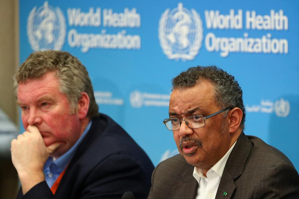 Director-General of the World Health Organization (WHO) Tedros Adhanom Ghebreyesus speaks next to Michael J. Ryan, Executive Director of the World Health Organization (WHO) Health Emergencies Programme during a news conference after a meeting of the Emergency Committee on the novel coronavirus (2019-nCoV) in Geneva, Switzerland January 30, 2020. REUTERS/Denis Balibouse
