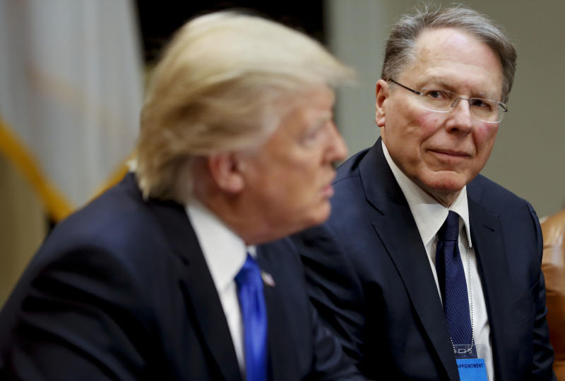 FILE - In a Feb. 1, 2017, file photo, National Rifle Associations (NRA) Executive Vice President and Chief Executive Officer Wayne LaPierre listens at right as President Donald Trump speaks in the Roosevelt Room of the White House in Washington. In the latest national furor over mass killings, the tremendous political power of the NRA is likely to stymie any major changes to gun laws. The man behind the organization is LaPierre, the public face of the Second Amendment with his bombastic defense of guns, freedom and country in the aftermath of every mass shooting. (AP Photo/Pablo Martinez Monsivais, File)
