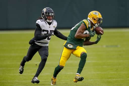 Green Bay Packers' Marquez Valdes-Scantling catches a touchdown pass in front of Jacksonville Jaguars' Sidney Jones during the first half of an NFL football game Sunday, Nov. 15, 2020, in Green Bay, Wis. (AP Photo/Matt Ludtke)
