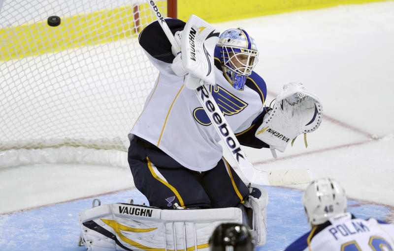 St. Louis Blues goalie Jake Allen (34) can't stop the goal shot by Dallas Stars Brett Ritchie, not shown, during the first period of an NHL pre-season hockey game Sunday, Sept. 15, 2013, in Dallas. (AP Photo/LM Otero)