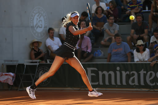 FILE - In this June 1, 2019, file photo, Amanda Anisimova plays a shot against Romania's Irina-Camelia Begu during their third round match at the French Open tennis tournament in Paris. American teenager Amanda Anisimovas representatives say she will not play at the U.S. Open because of the recent death of her father. A statement from her family issued Tuesday, Aug. 20, 29019, says they are shocked and saddened by the sudden passing of our father. Anisimova was coached by her father, Konstantin.(AP Photo/Pavel Golovkin, File)