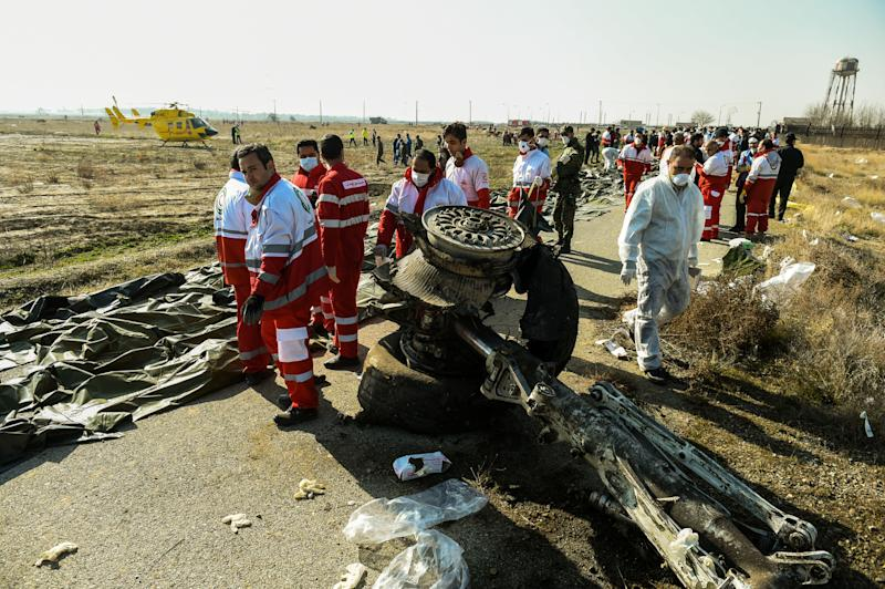 Rescue workers recover the bodies of victims of the wreckage of a Boeing Co. 737-800 aircraft, operated by Ukraine International Airlines, which crashed shortly after takeoff near Shahedshahr, Iran, on Wednesday, Jan. 8, 2020. (Photo: Ali Mohammadi/Bloomberg via Getty Images)