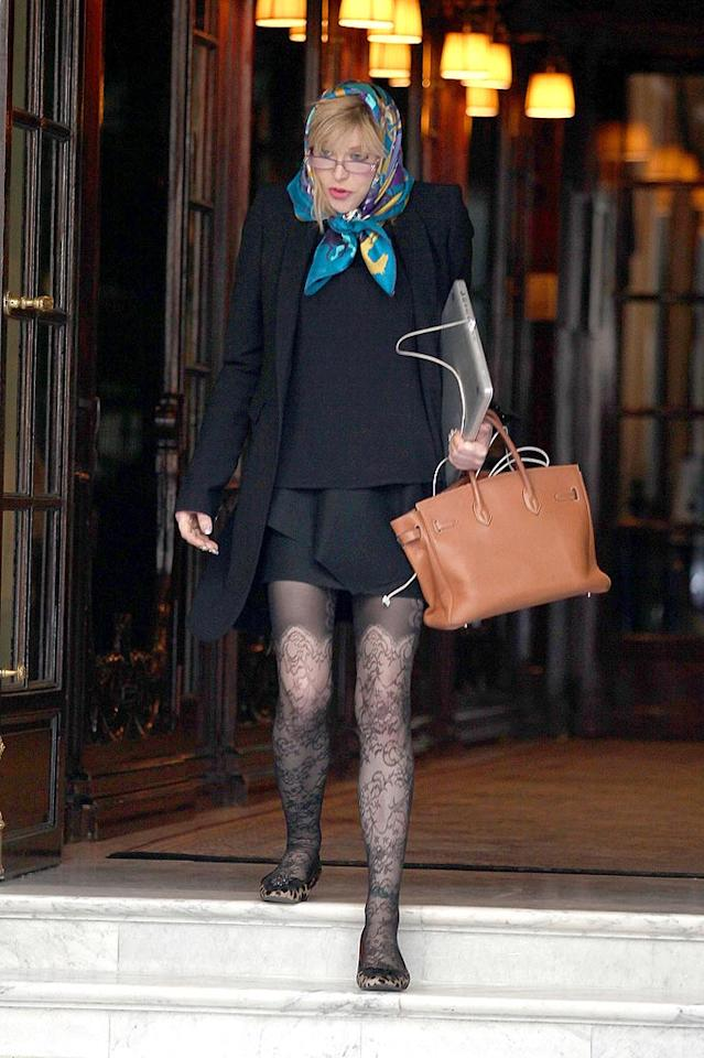 """Speaking of abominable outfits, the formerly fashionable Courtney Love was spotted leaving her hotel in Paris in this grungy, granny-like getup. A, A/<a href=""""http://www.pacificcoastnews.com/"""" target=""""new"""">PacificCoastNews.com</a> - August 25, 2010"""