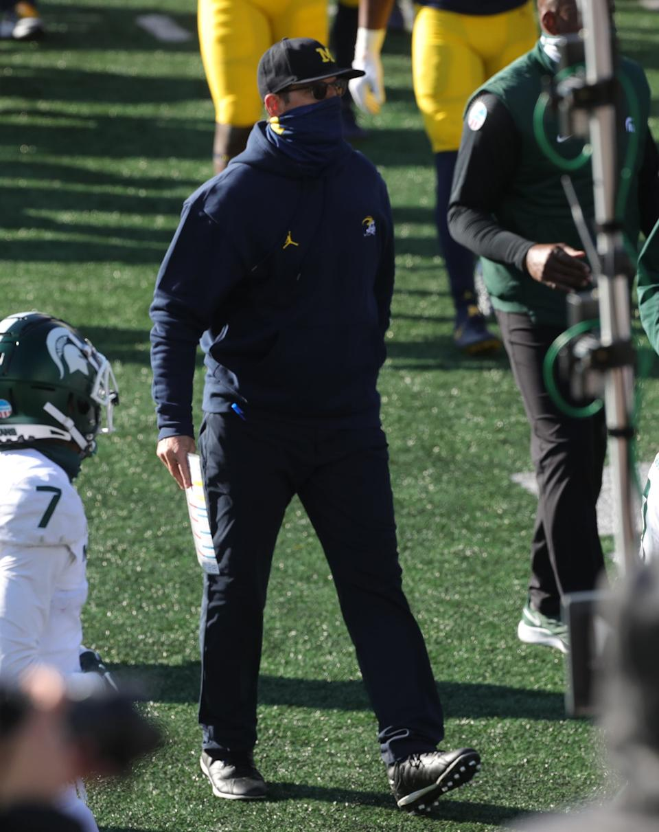 Michigan Wolverines coach Jim Harbaugh walks off the field after losing to Michigan State, 27-24, at Michigan Stadium in Ann Arbor, Saturday, Oct. 31, 2020.