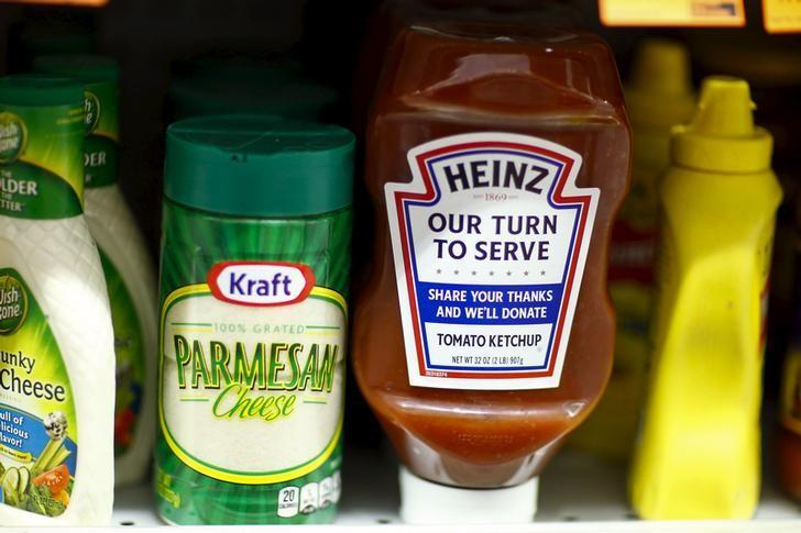 FILE PHOTO - A Heinz Ketchup bottle and a bottle of Kraft parmesan cheese are displayed in a grocery store in New York