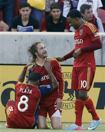 Real Salt Lake's Joao Plata (8) and Robbie Findley (10) celebrate with teammate Ned Grabavoy who scored against the San Jose Earthquakes during the first half of an MLS soccer game on Saturday, June 1, 2013, in Sandy, Utah. (AP Photo/Rick Bowmer)