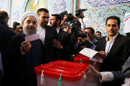 Iran's President Hassan Rouhani casts his ballot during the presidential election in Tehran, Iran, May 19, 2017. President.ir/Handout via REUTERS