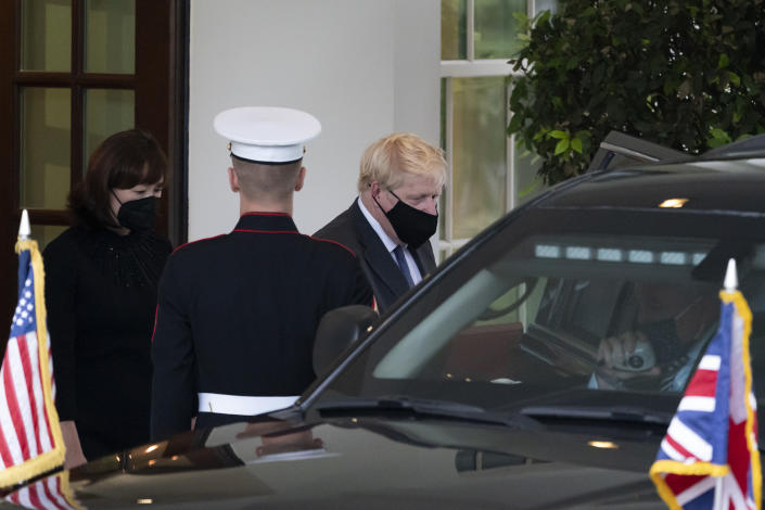 British Prime Minister Boris Johnson departs after a meeting with President Joe Biden in the Oval Office of the White House, Tuesday, Sept. 21, 2021, in Washington. (AP Photo/Alex Brandon)
