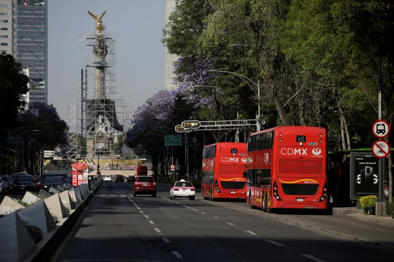 View shows an almost empty Reforma avenue in Mexico City