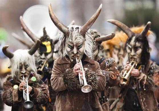 Musicians dressed for carnival perform at the Luzern-Carnival in Lucerne February 16, 2012.
