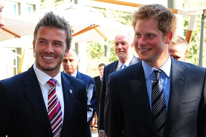 David Beckham and Prince Harry | Owen Humphreys/Getty Images