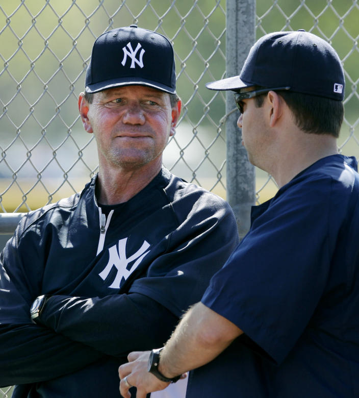 In this Wednesday, March 7, 2012, photo Scranton/Wilkes-Barre Yankees manager Dave Miley, left, listens to a colleague in the bullpen at the Yankees' minor league training complex in Tampa, Fla. Miley's team will play 144 games of their Triple-A season on the road this year, forced out of PNC Field because of a $40 million stadium renovation. (AP Photo/Kathy Willens)