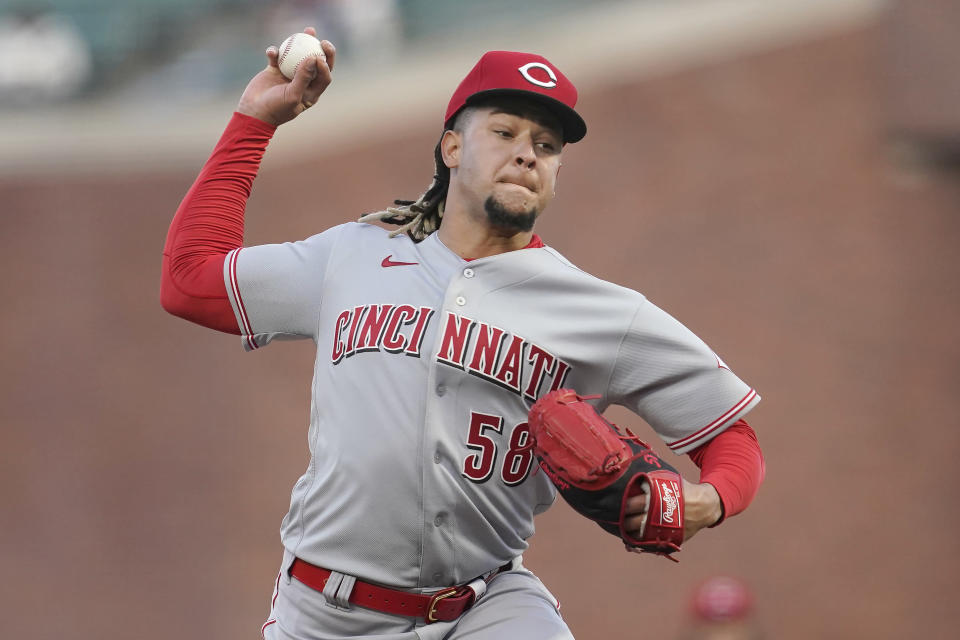 Cincinnati Reds pitcher Luis Castillo throws to a San Francisco Giants batter during the first inning of a baseball game in San Francisco, Tuesday, April 13, 2021. (AP Photo/Jeff Chiu)