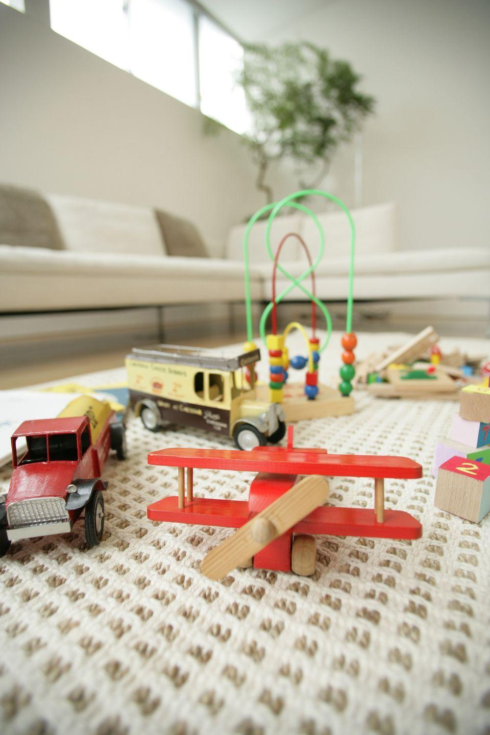 """<p>""""When your little ones play with Legos, figurines, or other multi-piece toys, start by laying out a large blanket or bed sheet first,"""" suggest Joy Cho, founder of <em><a href=""""http://ohjoy.blogs.com/"""" rel=""""nofollow noopener"""" target=""""_blank"""" data-ylk=""""slk:Oh Joy!"""" class=""""link rapid-noclick-resp"""">Oh Joy!</a></em>. That way, when it's time to clean up, you can bring the ends of the blanket together and quickly dump the toys back into their storage bucket. </p>"""