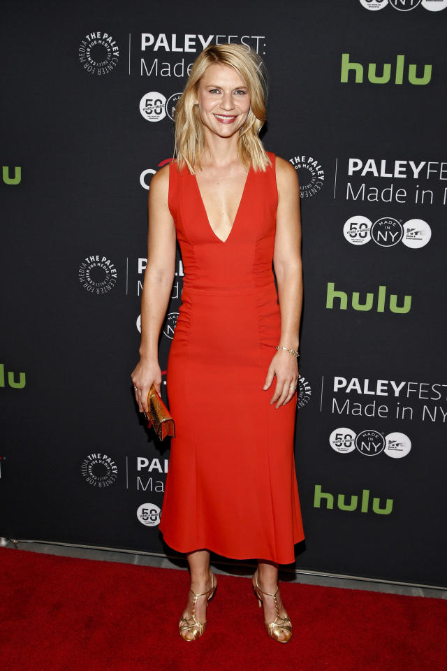 <p>The actress opted for a fitted and plunging red dress for PaleyFest - ensuring all eyes were on her.<i> [Photo: Getty]</i></p>