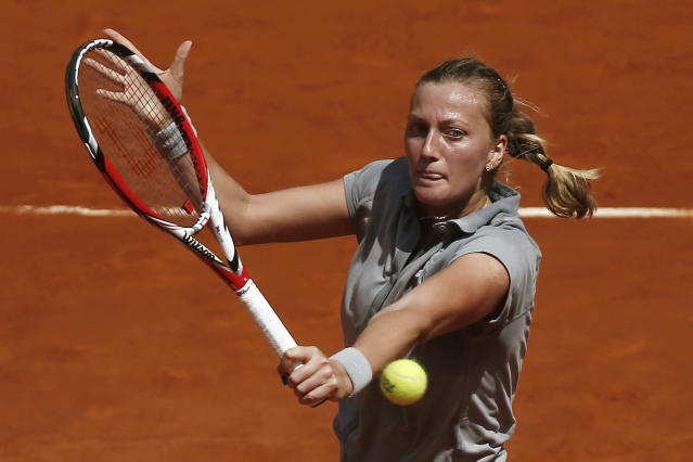 Petra Kvitova from the Czech Republic returns the ball during a Madrid Open tennis tournament semifinal match against Simona Halep from Romania in Madrid, Spain, Saturday, May 10, 2014. (AP Photo/Andres Kudacki)