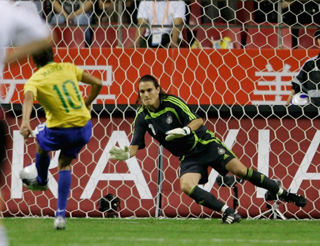 Nadine Angerer of Germany saves a penalty from Marta in the 2007 World Cup final. (Photo by Christof Koepsel/Bongarts/Getty Images)
