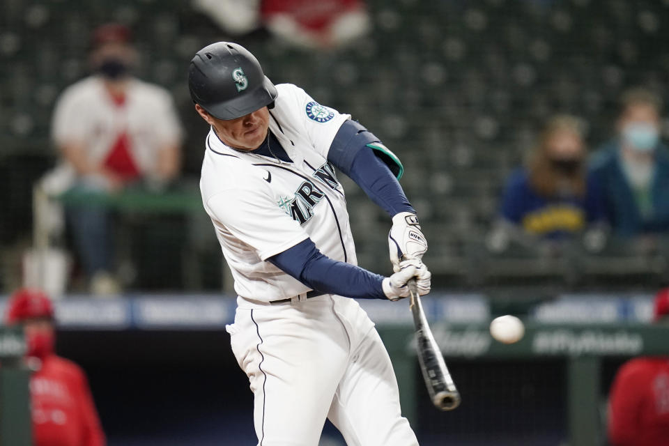 Seattle Mariners' Dylan Moore hits a two-run single against the Los Angeles Angels during the eighth inning of a baseball game Saturday, May 1, 2021, in Seattle. (AP Photo/Elaine Thompson)