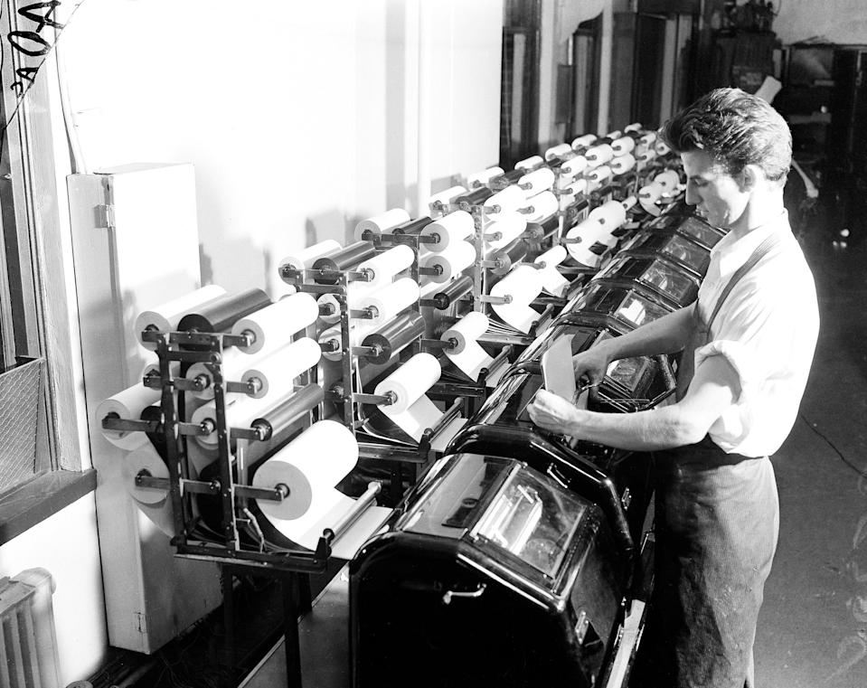 An Associated Press staffer reads copy from the election tabulator, Nov. 1936. (AP Photo)