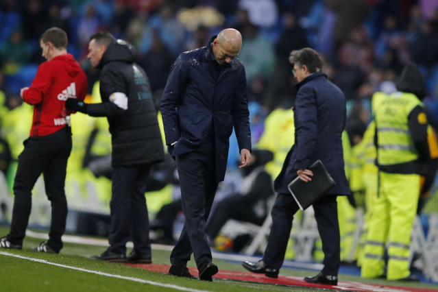 Real Madrid's head coach Zinedine Zidane reacts after Villarreal scored the winning goal during a Spanish La Liga soccer match between Real Madrid and Villarreal at the Santiago Bernabeu stadium in Madrid, Spain, Saturday, Jan. 13, 2018. (AP Photo/Paul White)