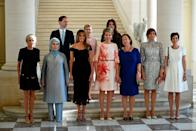 <p>Melania poses with other First Ladies of the world from Iceland, Slovenia, Bulgaria, Turkey, France, and the Queen of Belgium. She dressed for the diplomatic dinner in a Dolce & Gabbana black lace dress and black stilettos. </p>
