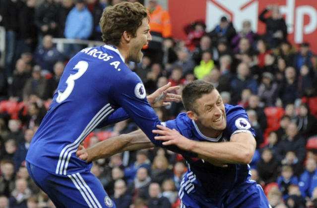 <p>Chelsea's Gary Cahill, right, celebrates after scoring during the English Premier League soccer match between Stoke City and Chelsea at the Britannia Stadium, Stoke on Trent, England, Saturday, March 18, 2017. (AP Photo/Rui Vieira) </p>