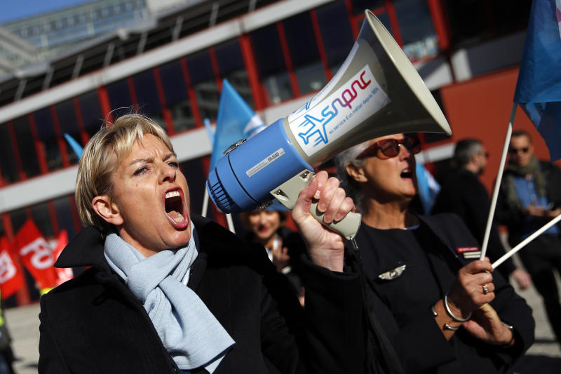 Air France flight crew shout slogans as they gather next to the company headquarters during a demonstration in Tremblay-en-France, outside Paris, Wednesday, April 11, 2018. About 30 percent of Air France flights scheduled on Wednesday are expected to be canceled as flight crews and ground staff started a seventh day of strike. (AP Photo/Christophe Ena)