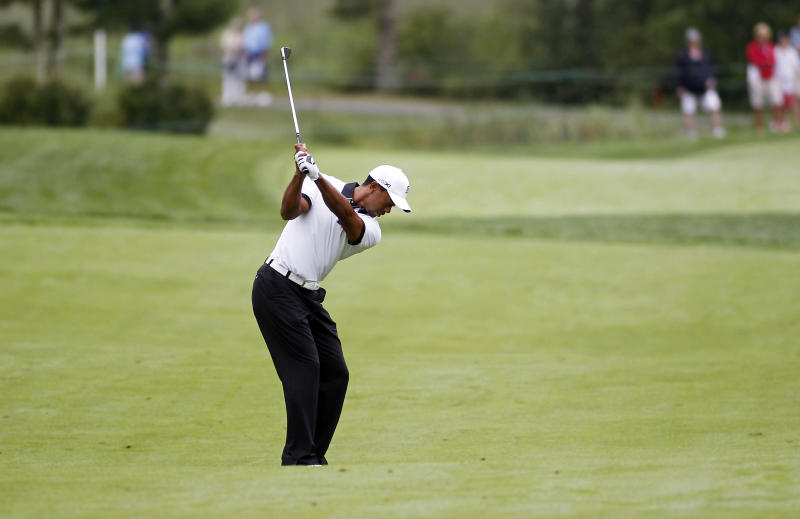 Tiger Woods hits his second shot on the 12th fairway during the pro-am round of the Deutsche Bank Championships in Norton, Mass., Thursday, Aug. 29, 2013. (AP Photo/Stew Milne)
