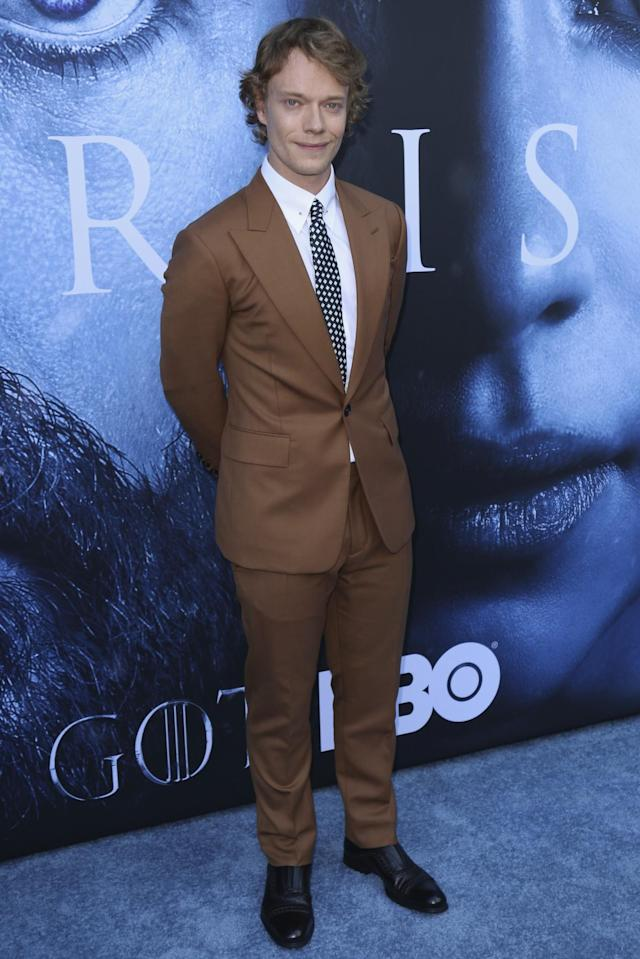 <p>Lily Allen's brother — otherwise known as Theon Greyjoy to the GOT community — wore a brown two-piece suit. (Photo: AP) </p>
