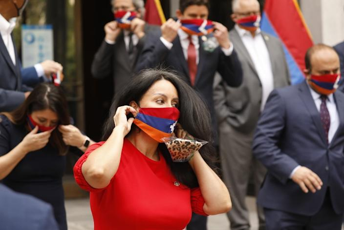 LOS ANGELES, CA - OCTOBER 05: LA City Council President Nury Martinez dons a face mask bearing the flag of the Republic Artsakh the tiny mountainous enclave recognized as part of Azerbaijan, but a population of ethnic Armenian, a number of elected officials posed for photos after they made statements at LA City Hall on the escalating conflict between Armenia and Azerbaijan. Their position is that the U.S. should call on Azerbaijan to cease fire and condemn its ally Turkey. For several weeks, Armenian-Americans across Los Angeles County have been staging demonstrations to bring awareness to the conflict pressing elected officials to speak. City Hall on Monday, Oct. 5, 2020 in Los Angeles, CA. (Al Seib / Los Angeles Times