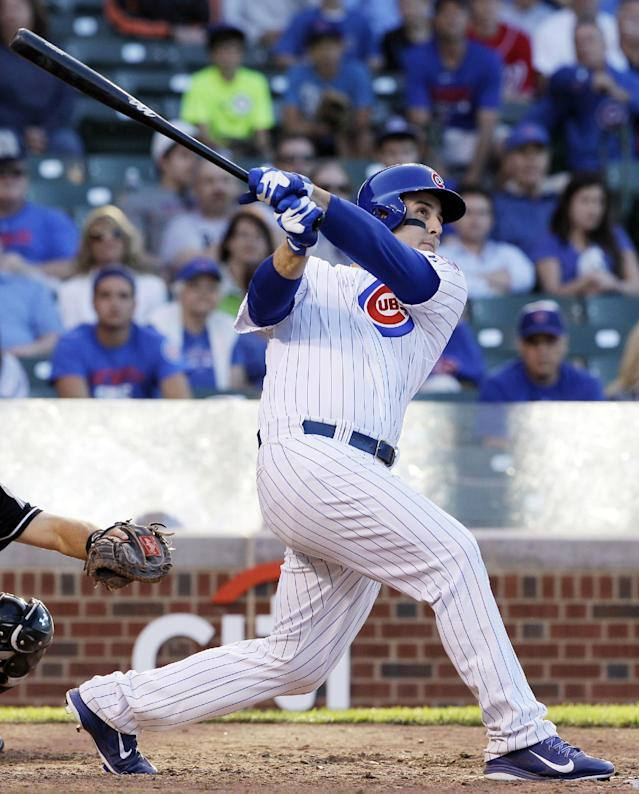 Chicago Cubs' Anthony Rizzo hits the game-winning two-run home run during the 13th inning of a baseball game against the Miami Marlins in Chicago, Friday, June 6, 2014. The Cubs won 5-3. (AP Photo/Nam Y. Huh)