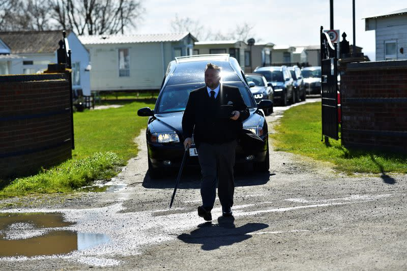 Funeral Director Bobby Palliser leads a cortege for a person who died after contracting COVID-19, through Leysdown-on-Sea on the Isle of Sheppey
